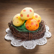Color Easter eggs in the nest — Stock Photo #69135665