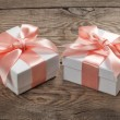 Beautiful gift box with a pink bow — Stock Photo #69135763