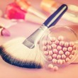 Powder and brush for makeup on the table. Vintage retro hipster — Stock Photo #69135767