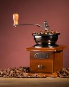 Coffee grinder on board — Stock Photo