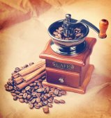 Coffee in a coffee grinder. Vintage retro hipster style version  — Stock Photo