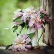 Bouquet peons on the window of the old boards — Stock Photo #76130425