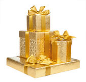 Boxes of gold wrapping paper isolated on white background — Stock Photo