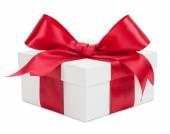 White gift box with red ribbon and bow isolated on a white backg — Stock Photo