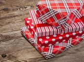 Beautiful gift boxes on the old boards. — Stock Photo