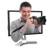 Photographer in the computer monitor — Stock Photo