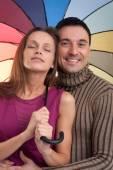 Happy couple with umbrella — Stock Photo
