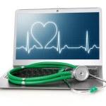 Постер, плакат: Laptop with heart rhythm ekg on screen