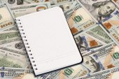 Notepad and dollars With Copy Space — Stock Photo