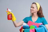 Woman holding different cleaning stuff — Stock Photo