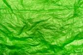Crumpled green plastic bag fragment as an abstract texture — Stock Photo