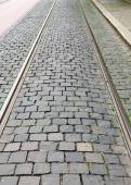 Fragment of a cobbled road useful as texture or background — Stock Photo