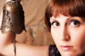 Woman with bell — Stock Photo