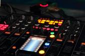 DJ mixer in nightclub — Stock Photo