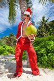Santa under tropical palm — Stock Photo