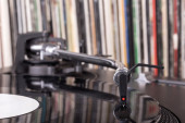 Dj stylus on spinning vinyl, record background  — Stok fotoğraf