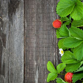 Background with ripe strawberry on wooden surface. — Stock Photo