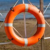 Lifebuoy on beach — Stock Photo