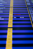 Flight information board in airport. — Stock Photo