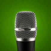 Wireless microphone on green background — Stock Photo