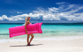 Woman with pink swimming mattress on tropical beach, Philippines — Stockfoto