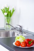 Vegetables in plate on worktop — Stock Photo
