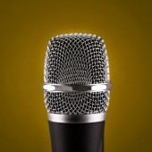 Wireless microphone on yellow background — Stock Photo