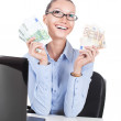 Smilling businesswoman  with euros in hands — Stock Photo #58545197