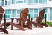 Wooden sun chair at resort near hotel — Stok fotoğraf