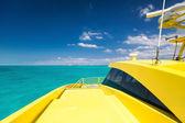 Yellow catamaran in caribbean sea — Stok fotoğraf