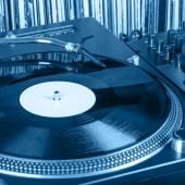 Dj needle stylus on spinning record — Stock Photo