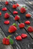 Strawberries and candy on wooden table — Stock Photo