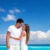 Newlyweds in love on white sandy beach — Stock Photo