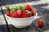 Ripe red strawberries on wooden table — Foto de Stock