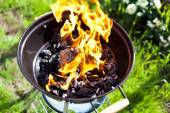 Barbecue charcoal in fire, preparing for grilling  — Stockfoto