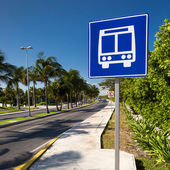 American road public bus stop sign on caribbean street  — Stock Photo