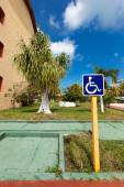 Blue handicapped sign with wheelchair — Stock Photo
