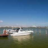 Speedboats moored to a jetty — Stock Photo
