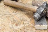 Hammer on a wooden background — Stok fotoğraf