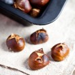 Roasted chestnuts in a pan — Stock Photo #59157889
