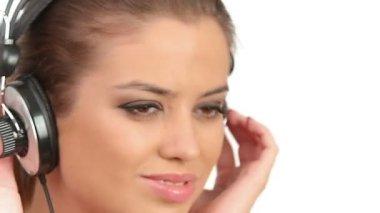 Beautiful lady listening music in headphones — Stock Video