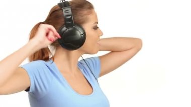 Beautiful lady listening music in headphones — Stock Video
