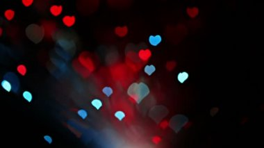 Abstract Valentine's day heart shaped bokeh background in red and blue tones — Stock Video