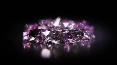 Jewel stones heap in violet tones rotating over dark background — Stock Video