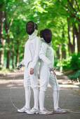 Two rapier fencers women staying in park alley getting ready for — Stock Photo