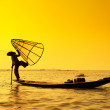 Inle lake Intha fisherman on boat at amazing sunset — Stock Photo #52404067