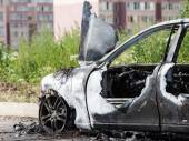Arson fire burnt wheel car vehicle junk — Stock Photo