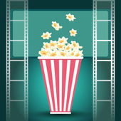 Package with popcorn and and film strip — Stock Vector