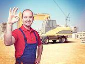 Handyman at construction site — Stock Photo