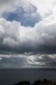 Dark clouds at Sicily coast. — Stock Photo
